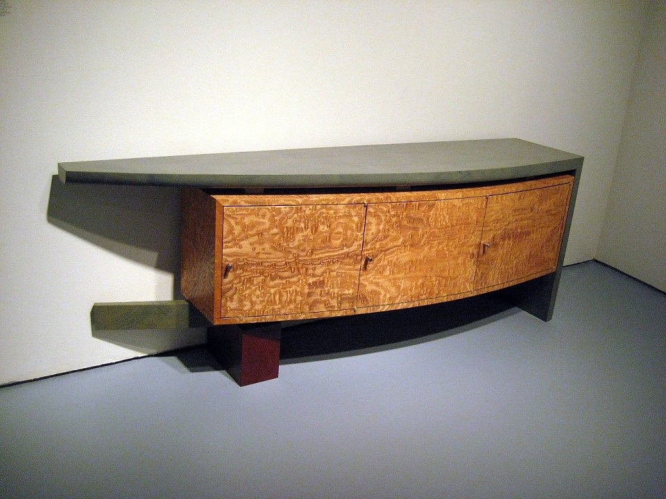 Low Wooden Credenza using arched shapes in golden burlwood with black top.