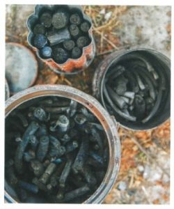 charcoal sticks in containers