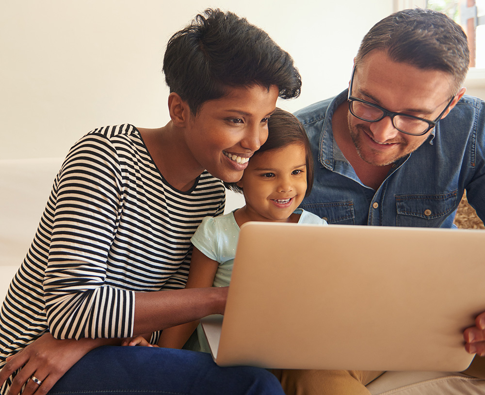 parents and child using computer