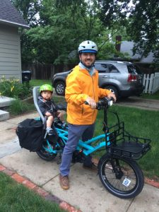 dad and kid ready to ride on cargo bike