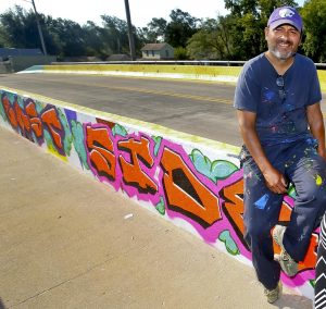 Jamie Colon with mural