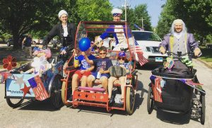 Cargo bikes loaded and driving in Collins Park 4th of July parade
