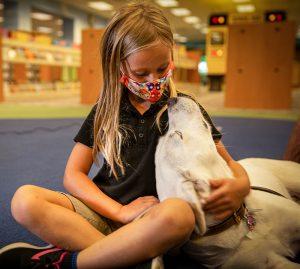child Anna and dog Cheyenne
