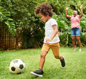 grandma grandson playing soccer