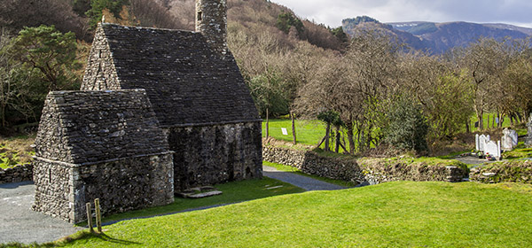 Traditional Irish Rock Church on Green rolling Hills in Glendalough in the countryside of Northern Ireland